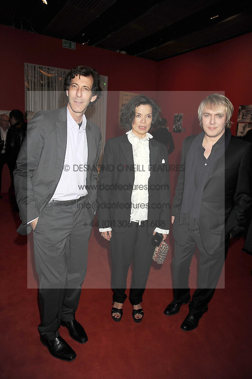 """Left to right, RALPH RUGOFF the director of the Hayward Gallery, BIANCA JAGGER and NICK RHODES at an exhibition of work by Andy Warhol entitled """"Other Voices, Other Rooms"""" at The Hayward Gallery, Southbank Centre, London SE1 on 6th October 2008."""