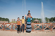 Erbil, Iraqi Kurdistan. A family at the Abdulrahman Park, one of the biggest parks of Middle East. Many poor families come to Erbil from different parts of the country in order to find a job and a better life quality.
