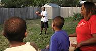 Terry Talbott, Jr. catches a football thrown by his brother Terrence; watched by (from left) cousins DeMorea Benson, 7; Devoni'ye Benson, 6 and mother Natasha White,  Sunday August 12, 2007.
