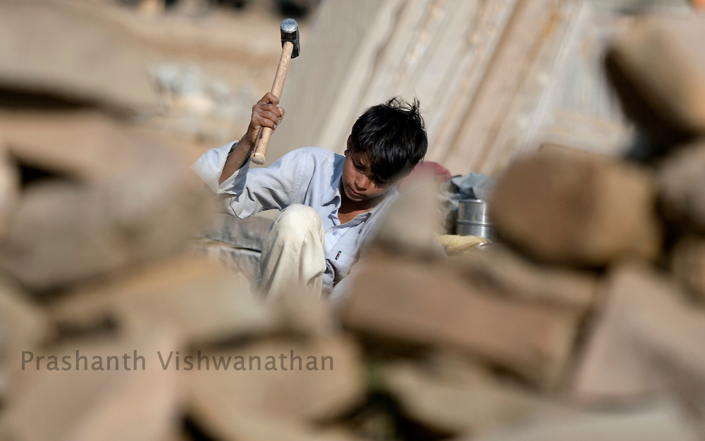 PRASHANTH VISHWANATHAN, INDIA - DECEMBER 18: Mul Chand an eight year old boy works at a stone quarry in Dabi near Kota, in Rajasthan,  India.(Photo by Prashanth Vishwanathan/Getty Images for the Forbes)