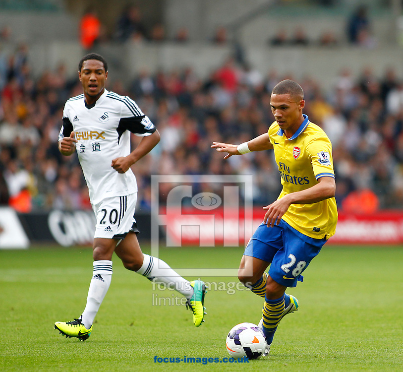 Picture by Mike  Griffiths/Focus Images Ltd +44 7766 223933<br /> 28/09/2013<br /> Jonathan De Guzman of Swansea City and Kieran Gibbs of Arsenal during the Barclays Premier League match at the Liberty Stadium, Swansea.