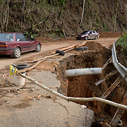 OCTOBER 18 - MARICAO, PUERTO RICO - <br /> Damaged road in Maricao forces drivers to slow down almost one month  following the destructive path of hurricane Maria.<br /> (Photo by Angel Valentin for NPR)