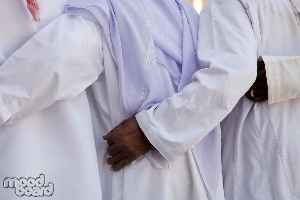 UAE Dubai group of traditionally dressed Muslim men perform a song for visitors to the Bastakia