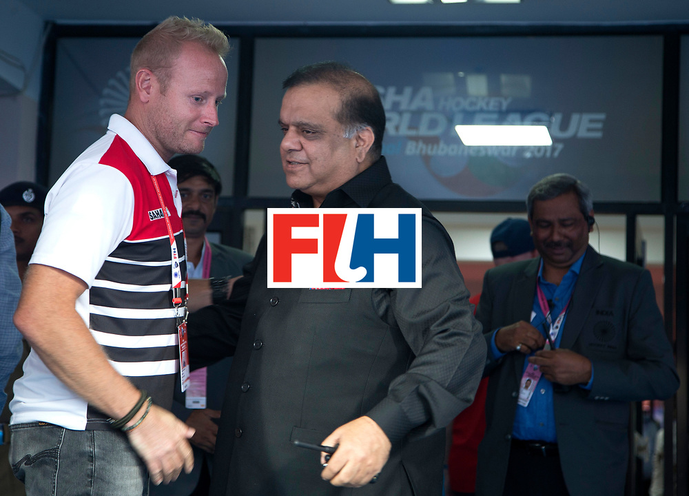 BHUBANESWAR - The Odisha Men's Hockey World League Final . Match ID 01 . India coach Sjoerd Marijne with FIH president Narinder Batra.    WORLDSPORTPICS COPYRIGHT  KOEN SUYK