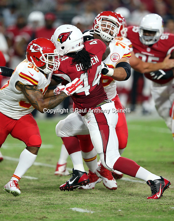 Arizona Cardinals outside linebacker Markus Golden (44) gets double team blocked during the 2015 NFL preseason football game against the Kansas City Chiefs on Saturday, Aug. 15, 2015 in Glendale, Ariz. The Chiefs won the game 34-19. (©Paul Anthony Spinelli)