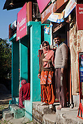 Palampur. India: A couple on the stoop of a small shop in Five House village, on a walk from the Country Cotttages, in the Chandpur Tea Estate. (Photo: Ann Summa).