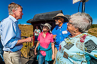 Governor John Hickenlooper (of Colorado) greets passengers on the open air viewing platform aboard the Cumbres & Toltec Scenic Railroad, from Antonito to Osier, Colorado during peak autumn color.