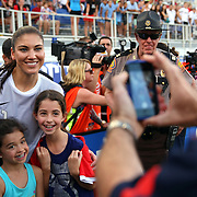 U.S. goalkeeper Hope Solo (1) poses with young fans after an international friendly soccer match between the United States Women's National soccer team and the Russia National soccer team at FAU Stadium on Saturday, February 8, in Boca Raton, Florida. The U.S. won the match by a score of 7-0. (AP Photo/Alex Menendez)