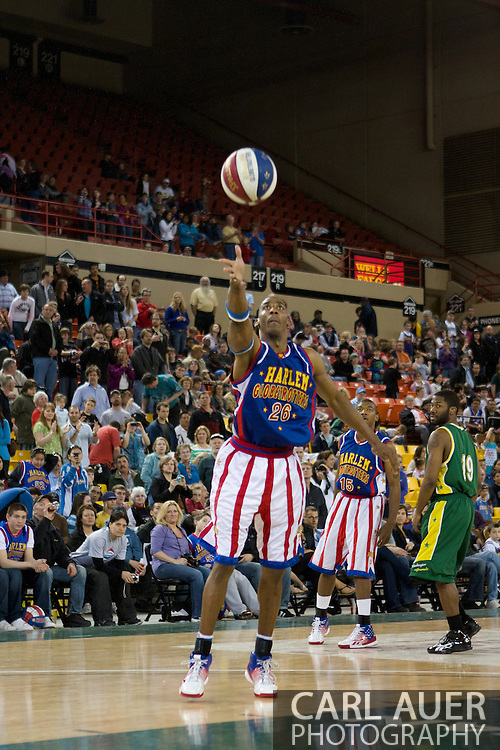 April 30th, 2010 - Anchorage, Alaska:  Harlem Globetrotter Hi-Lite Bruton tosses a pass Friday night at the Sullivan Arena.