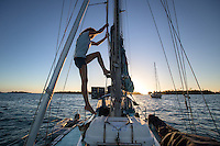 "Patagonia ambassador Liz Clark doing some minor repair work on her sailboat ""Swell."" French Polynesia"