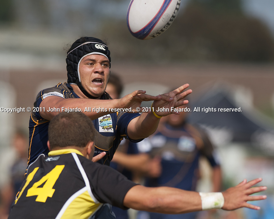 Belmont Shore's Michael Teo passes the ball in the Southern California Youth Rugby Boys U19 Championship match against Oceanside at Webster Middle School, Los Angeles, Calif., Saturday, May 7, 2011.