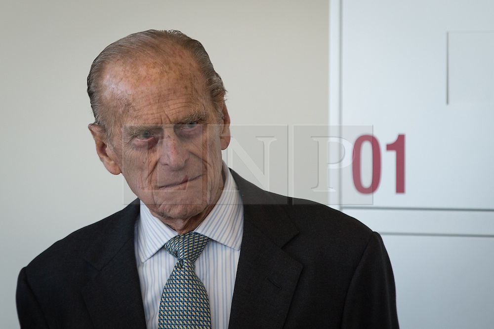 © Licensed to London News Pictures . 14/11/2013 . Manchester , UK . Prince Philip the Duke of Edinburgh on the tour of the building . Queen Elizabeth II and the Duke of Edinburgh visit the Coop building at 1 Angel Square , Manchester , this morning ( 14th November 2013 ) . Photo credit : Joel Goodman/LNP