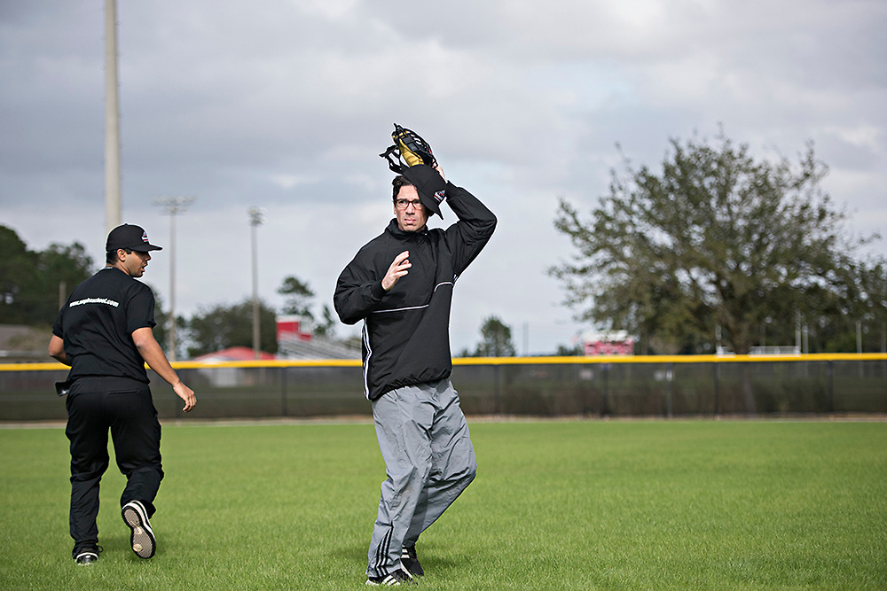Seth Stevenson works on the basics, like getting his mask off without losing his hat, during the first week of training at the Wendelstedt Umpire School in Daytona Beach, Fla.
