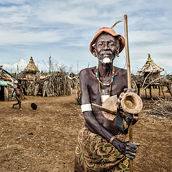 Dasanech old man in his village, Omorate, Ethiopia, Africa