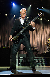 © Licensed to London News Pictures. 17/03/2015. London, UK.   Spandau Ballet performing live at The O2 Arena.   In this picture - Martin Kemp. Spandau Ballet are a British new wave band formed in London in the late 1970s, composed of members Tony Hadley (lead vocals, synthesisers), Gary Kemp ( guitar, keyboards, backing vocals), Steve Norman (saxophone, guitar, percussion), John Keeble –(drums, backing vocals), <br /> Martin Kemp (bass).  Photo credit : Richard Isaac/LNP