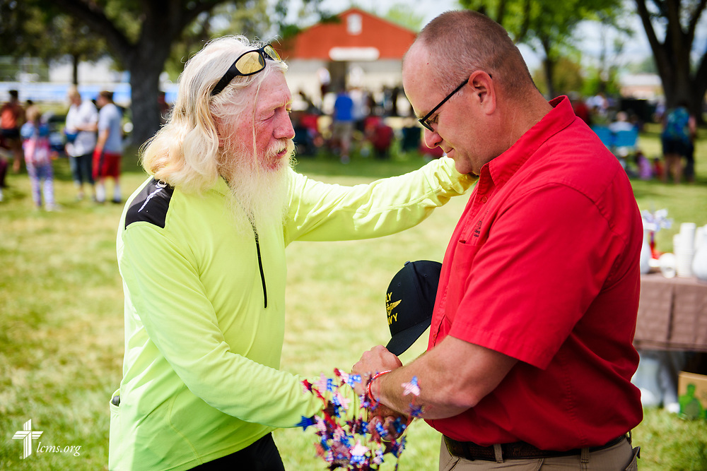 Keith Forysthe prays with the Rev. Michael Musegades, pastor of Trinity Lutheran Church, Grangeville, Idaho, at the TLC4Vets outreach tent at the Grangeville Border Days Independence Day celebration and parade on Tuesday, July 4, 2017, in Grangeville. LCMS Communications/Erik M. Lunsford
