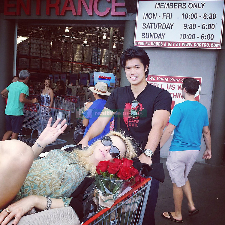 "Courtney Love releases a photo on Twitter with the following caption: """"That day @RossButler  made me go to Costco HOLEsale #tbt #rossbutler #13reasonswhy #costco #holesale 😁"""". Photo Credit: Twitter *** No USA Distribution *** For Editorial Use Only *** Not to be Published in Books or Photo Books ***  Please note: Fees charged by the agency are for the agency's services only, and do not, nor are they intended to, convey to the user any ownership of Copyright or License in the material. The agency does not claim any ownership including but not limited to Copyright or License in the attached material. By publishing this material you expressly agree to indemnify and to hold the agency and its directors, shareholders and employees harmless from any loss, claims, damages, demands, expenses (including legal fees), or any causes of action or allegation against the agency arising out of or connected in any way with publication of the material."