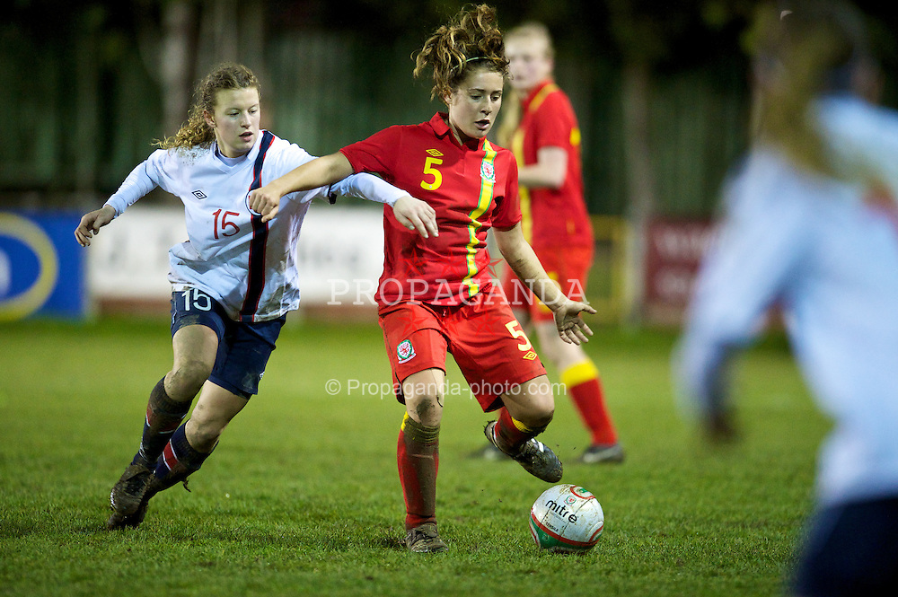 NEWTOWN, WALES - Friday, February 1, 2013: Wales' Danielle Oates in action against Norway's Synne Hansen during the Women's Under-19 International Friendly match at Latham Park. (Pic by David Rawcliffe/Propaganda)