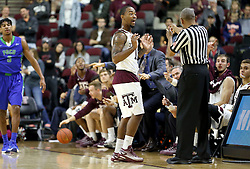 Texas A&M's Anthony Collins (11) reacts after a out of bounds call by a referee during a NCCA college basketball game against Florida Gulf Coast University in College Station, Texas, Wednesday, Dec. 2, 2015.  (AP Photo/Sam Craft)