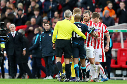 Stoke City Manager Mark Hughes watches as Fabian Delph of Manchester City argues with Erik Pieters of Stoke City at full time - Mandatory byline: Matt McNulty/JMP - 07966 386802 - 05/12/2015 - FOOTBALL - Britannia Stadium - Stoke, England - Stoke City v Manchester City - Barclays Premier League