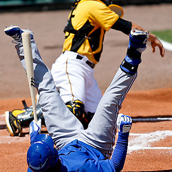 Mar 13, 2013; Bradenton, FL, USA; Toronto Blue Jays right fielder Anthony Gose (8) falls back after nearly being hit by a pitch during the top of the first inning of a spring training game against the Pittsburgh Pirates at McKechnie Field. Mandatory Credit: Derick E. Hingle-USA TODAY Sports
