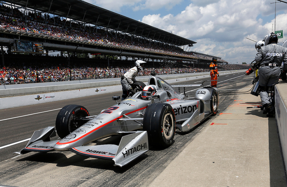 Juan Pablo Montoya exits his pit stop during the 100th running of the Indianapolis 500 May 29, 2016.