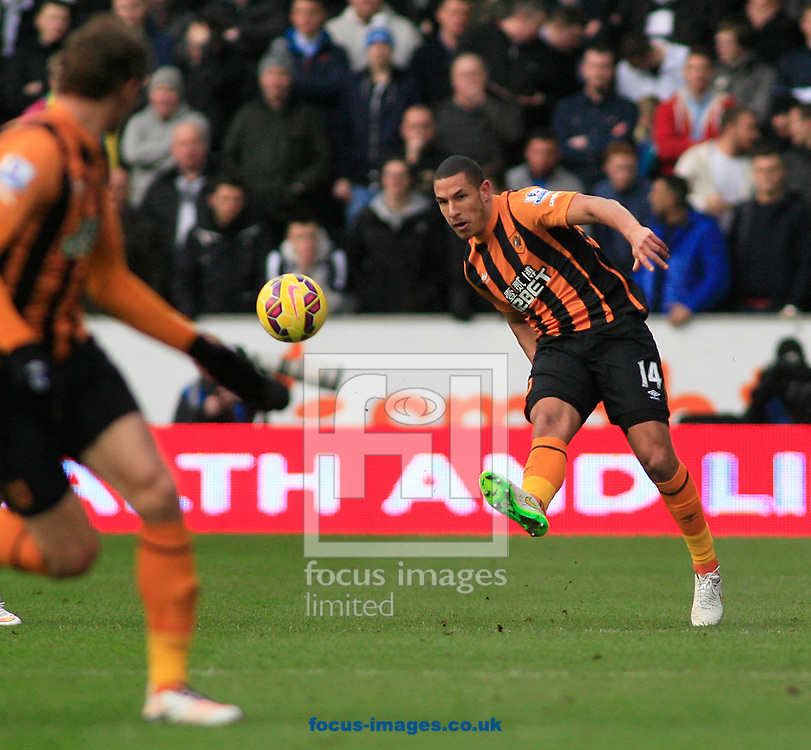 Jake Livermore (right) of Hull City plays a through ball during the Barclays Premier League match at KC Stadium, Hull<br /> Picture by Richard Gould/Focus Images Ltd +44 7855 403186<br /> 31/01/2015
