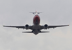 © Licensed to London News Pictures. 21/12/2018. Gatwick, UK. An aircraft takes off from Gatwick as another (top) approaches for landing as flights resume. Further delays are expected today after two days of disruption due to multiple sightings of drones over the airfield. Thousands of passengers have been standed as flights have been cancelled or diverted. Police are still hunting the drone operator. Photo credit: Peter Macdiarmid/LNP