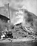 World War 2: Finland. Bombing of Helsinki by the Russians.  Block of flats in flames after a direct hit.