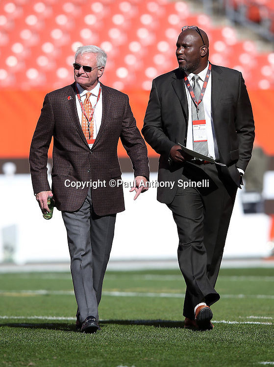 "(L-R) Cleveland Browns owner James Arthur ""Jimmy"" Haslam walks across the field with Cleveland Browns general manager Ray Farmer during pregame warmups before the 2015 week 8 regular season NFL football game against the Arizona Cardinals on Sunday, Nov. 1, 2015 in Cleveland. The Cardinals won the game 34-20. (©Paul Anthony Spinelli)"