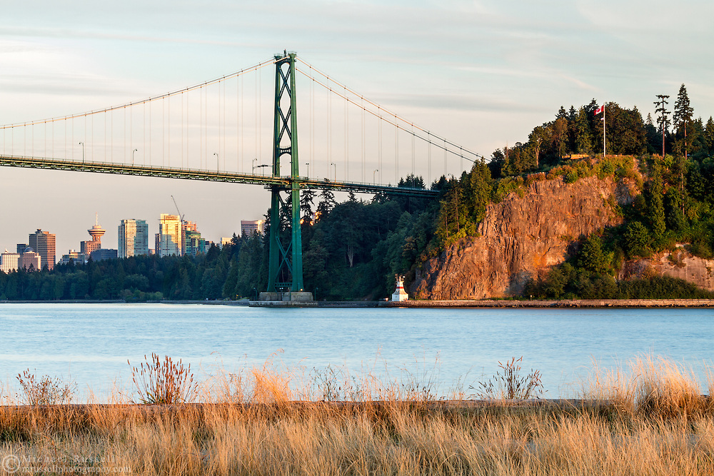 The Lions Gate Bridge, Stanley Park's Prospect Point and the buildings of downtown Vancouver from Ambleside Beach Park in North Vancouver, British Columbia, Canada