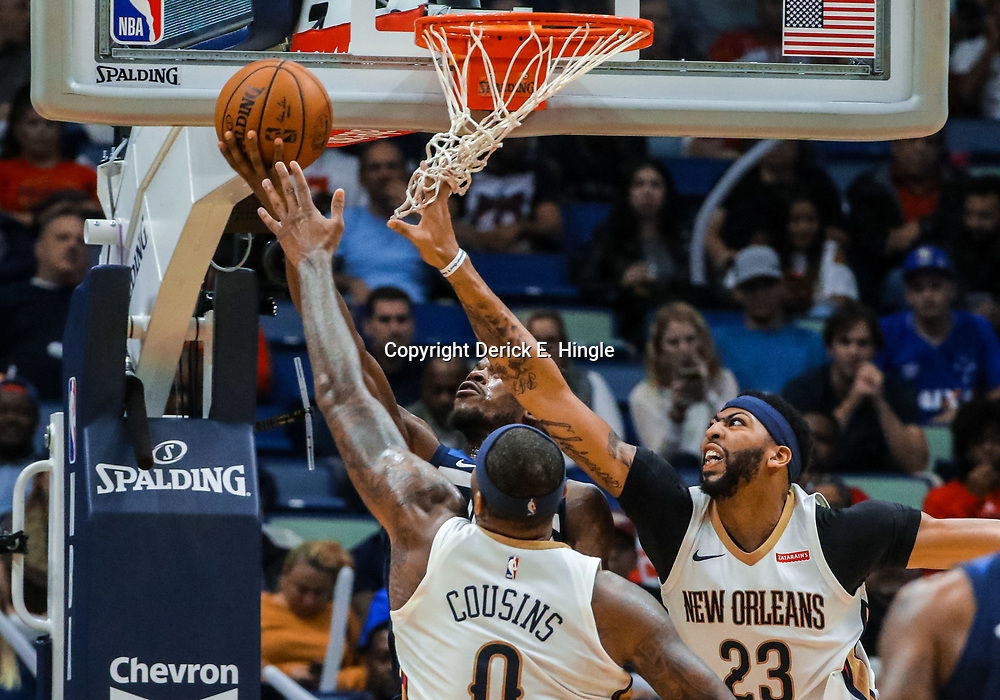 Nov 1, 2017; New Orleans, LA, USA; Minnesota Timberwolves forward Andrew Wiggins shoots and scores over New Orleans Pelicans forward Anthony Davis (23) and center DeMarcus Cousins (0) during the second half of a game at the Smoothie King Center. The Timberwolves defeated the Pelicans 104-98. Mandatory Credit: Derick E. Hingle-USA TODAY Sports