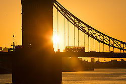 © Licensed to London News Pictures. 03/09/2017. LONDON, UK.  A bus passes over Tower Bridge during a golden sunrise this morning on the River Thames, as the capital wakes up to a chilly and clear autumn morning. Photo credit: Vickie Flores/LNP