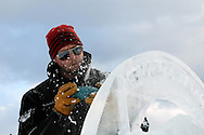 Man ice carving at event in Avon, Colorado, USA, North America