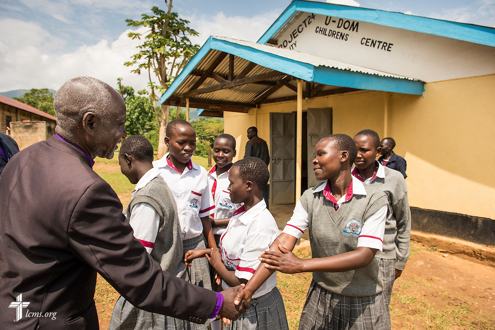 U-Dom ELCK (Evangelical Lutheran Church in Kenya) Project 24 site students greet the local ELCK bishop on Friday, June 24, 2016, in Chepareria, Kenya.  LCMS Communications/Erik M. Lunsford