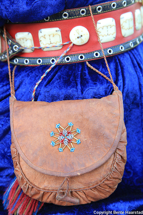 Sami duodji, sami traditional handicraft. Purse made of leather of reindeer and pearls.