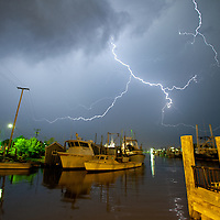 Lightning streaking through the sky seen from the Belford Seafood Co-Operative in Belford New Jersey.
