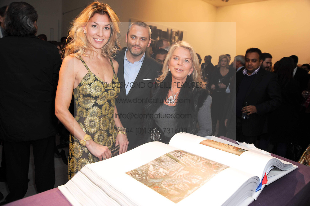 Left to right, STASHA PALOS, KARL FOWLER and LADY GREEN at a reception to launch the Saatchi Opus held at the Saatchi Gallery, King's Road, London on 26th November 2009.