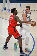 Toronto Raptors forward OG Anunoby (3) guards Dallas Mavericks point guard Luka Doncic (77) in the first quarter during an NBA basketball game, Saturday, Nov. 16, 2019, in Dallas. The Mavericks defeated the Raptors 110-102. (Wayne Gooden/Image of Sport)