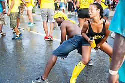 Vernon Araujo and Glenda Moise of JouvertNation.  Carnival 2015 continues Jouvert morning on the Watefront.  St. Thomas, VI.  30 April 2015.  © Aisha-Zakiya Boyd