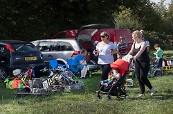 © Licensed to London News Pictures. 24/09/2016. Five Oaks, UK. Competitors and their families enjoy a day out in the sunshine at the Lawn Mower Racing World Championships. A weekend long set of races will see a World Champion announced on Sunday. Photo credit: Peter Macdiarmid/LNP