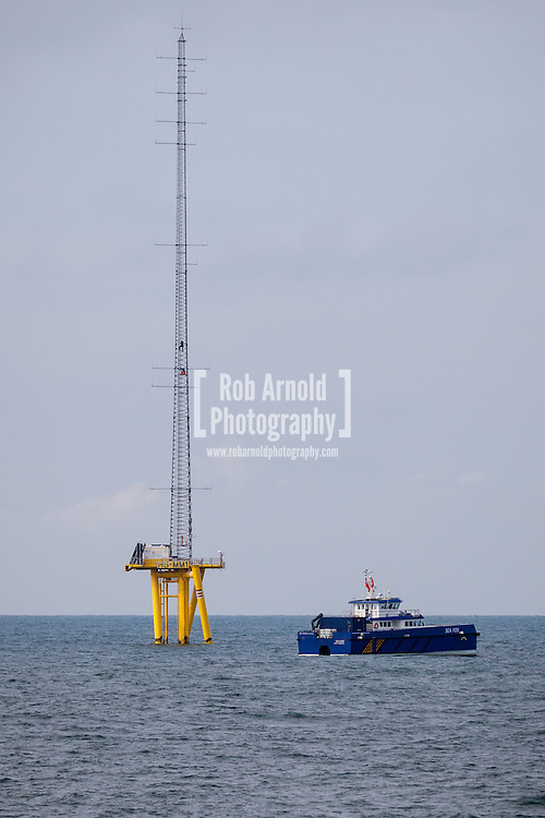 A Wind Cat, Sea Fox, waiting for workers climbing the Met mast on the Hornsea (Heron) Offshore Wind Farm in the North Sea.