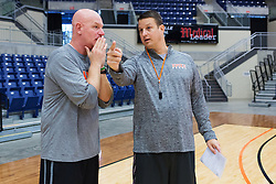 UPike Men's head basketball coach Kelly Wells, right, and assistant Coach Randy Casey talk about performance during team workouts, Wednesday, Sept. 24, 2014 at the Eastern Kentucky Expo Center in Pikeville. <br /> <br /> Photo by Jonathan Palmer, Special to the CJ