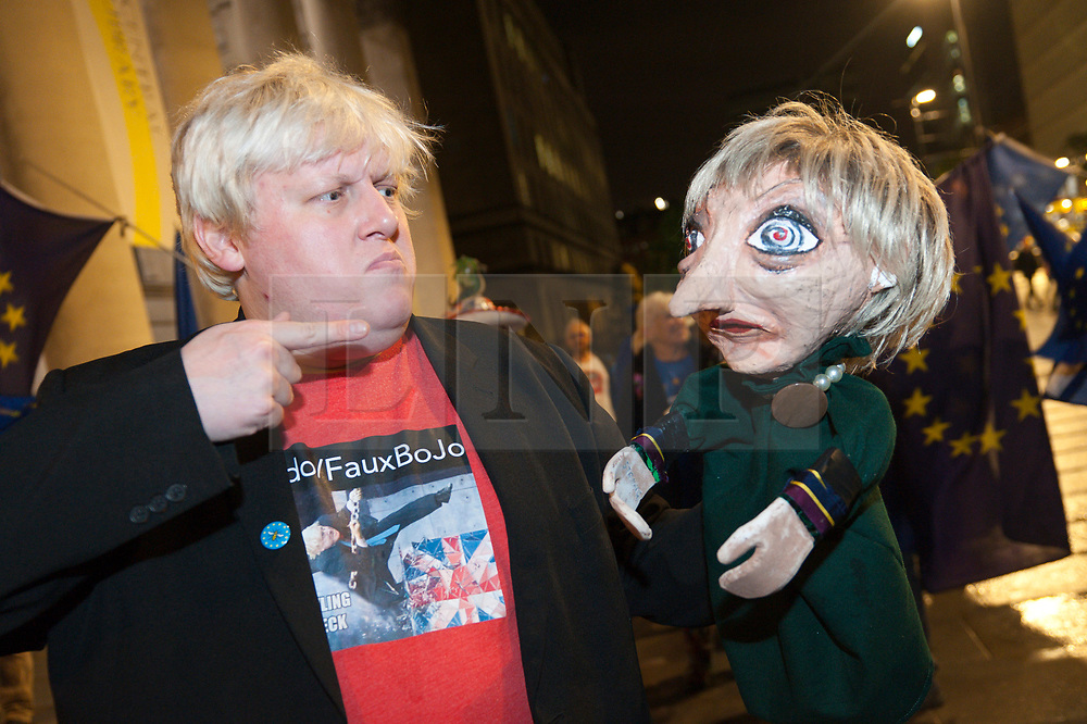 30/09/2017. Manchester, UK. Boris Johnson lookalike puts on a very entertaining anti-Brexit performance. Anti-Brexit, protesters gather outside the conference centre Manchester UK. and make their voice heard by performing satirical cabaret on the eve of the Tory Party Conference. Photo credit: Graham M. Lawrence/LNP