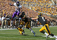 September 15 2012: Northern Iowa Panthers running back David Johnson (7) jumps over Iowa Hawkeyes defensive back B.J. Lowery (19) as he is grabbed by linebacker Anthony Hitchens (31) and defensive back Tanner Miller (5) closes in during the first quarter of the NCAA football game between the Northern Iowa Panthers and the Iowa Hawkeyes at Kinnick Stadium in Iowa City, Iowa on Saturday September 15, 2012. Iowa defeated Northern Iowa 27-16.
