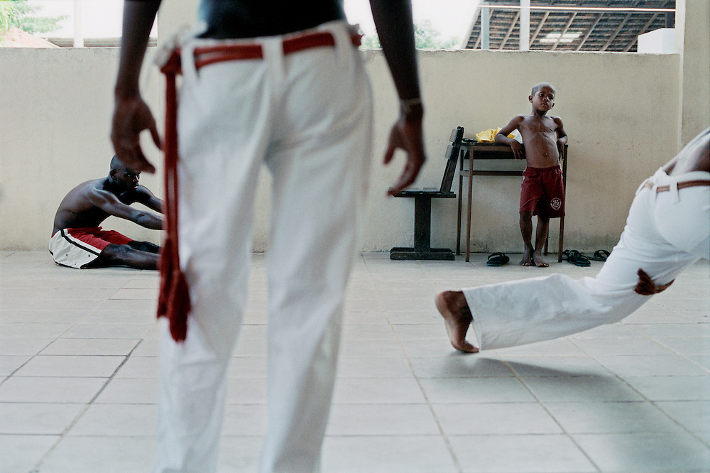 Afro Reggae capoeira class. Discipline, commitment, respect are major values for those involved. As a result most of these children have reached a very high level in their discipline. These are rehearsals just before their major concert at Rock in Rio, the biggest rock festival in Brazil lasting a whole week. Professionals are hired to train members of the band to the level that is expected at such a major event. Rio de Janerio, Brazil. 2001
