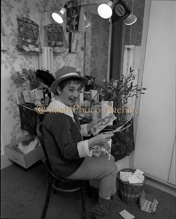 "03/01/1969.01/03/1969.03 January 1969.Maureen Potter, star of the pantomime ""Tom Thumb"", reads birthday cards and greetings messages in her dressing room at the Gaiety Theatre, just before curtain-up. A party was given for her on the stage after the show on Saturday 4th. Maureen had stared in the pantomime on 25 of her birthdays in the previous 27 years."