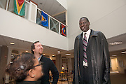 18069Mr. Manute Bol, Founder os the Ring Foundation, and former NBA player visting the Sports in Africa Annual Conference..Winsome Chunnu(glasses), Matt Kirwin(Beard)
