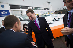 © London News Pictures. 30/01/2014. London, UK. Deputy Prime Minister NICK CLEGG (centre) during a visit to Ace Cafe in North London where he announced a multi million pound funding allocation for more electric car charging points across the country. Photo credit: Ben Cawthra/LNP