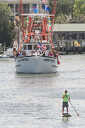 April 30, 2017 - Charleston, SC, United States of America - Decorated shrimp boats parade past the commercial fishing docks down Shem Creek during the annual Blessing of the Fleet signifying the start of the commercial shrimping season April 30, 2017 in Mount Pleasant, South Carolina. Coastal shrimping is part of the low country heritage but has been declining rapidly with rising costs and increased foreign competition. (Credit Image: © Richard Ellis via ZUMA Wire)